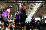 "The Rose City Rollers Wheels of Justice all-star team and the Bay Area Derby Girls wait during a ""sun delay"" at the semi-finals of the 2012 WFTDA Western Regionals. Bay Area eventually won and advanced to the national tournament."