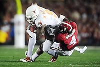 Jan 7, 2010; Pasadena, CA, USA; Texas Longhorns wide receiver Malcolm Williams (9) is tackled by Alabama Crimson Tide defensive back Mark Barron (4) during the first quarter of the 2010 BCS national championship game at the Rose Bowl.  Mandatory Credit: Mark J. Rebilas-