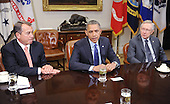 United States President Barack Obama, center, makes remarks to the press pool as he meets with a bipartisan group of congressional leaders including Speaker of the U.S. House John Boehner (Republican of Ohio), left, and U.S. Senate Majority Leader Harry Reid (Democrat of Nevada), right, in the Roosevelt Room of the White House on November 16, 2012 in Washington, DC. .Credit: Olivier Douliery / Pool via CNP