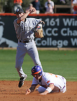 Clemson's Jeff Schaus (3) is out at second in the first half of a double play by University of South Carolina second baseman Scott Wingo (8) in a game between the Clemson Tigers and USC Gamecocks on March 2, 2008, at Doug Kingsmore Stadium in Clemson. Photo by: Tom Priddy/Four Seam Images