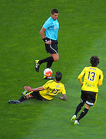 Referee Shaun Evans tries to get out of the wau of Vinnie Lia's pass during the A-League football match between Wellington Phoenix and Newcastle Jets at Westpac Stadium, Wellington, New Zealand on Sunday, 11 October 2015. Photo: Dave Lintott / lintottphoto.co.nz