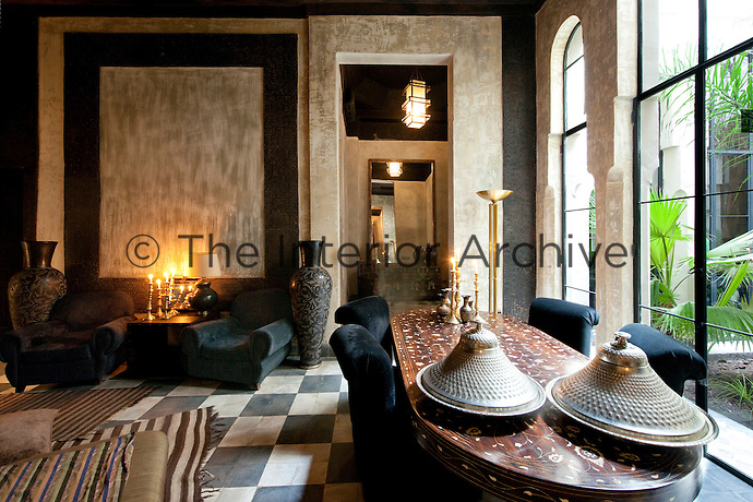 The dining room at the Riad Dar Darma with its delicate inlaid wooden table overlooking the inner garden
