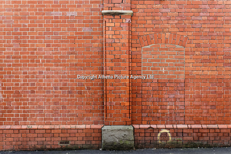 A brick wall in Ebenezer Street near High Street in Swansea, Wales, UK. Thursday 16 August 2018