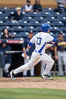 Ryan Day (13) of the Duke Blue Devils follows through on his swing against the California Golden Bears at Durham Bulls Athletic Park on February 20, 2016 in Durham, North Carolina.  The Blue Devils defeated the Golden Bears 6-5 in 10 innings.  (Brian Westerholt/Four Seam Images)
