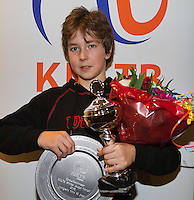 Almere, Netherlands, December 6, 2015, Winter Youth Circuit, Overall winner of the circuit  boys12 years:  Luka Novakovic with the trophy<br /> Photo: Tennisimages/Henk Koster