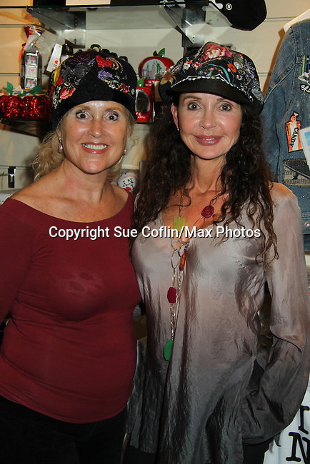 """General Hospital's Jackie Zeman poses with her sister Lauren who tries on Jane Elissa's many Hats for Health on September 10, 2010 at the New York Marriott Marquis, New York, New York as Daytime's TV and  Broadway stars get involved in helping launch Jane Elissa's """"Hats For Health"""" to promote awareness and to raise money for Leukemia and cancer research.   (Photo by Sue Coflin/Max Photos)"""