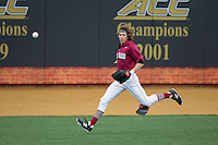 Harvard Crimson left fielder Trent Bryan (23) chases down the baseball during the game against the Wake Forest Demon Deacons at David F. Couch Ballpark on March 5, 2016 in Winston-Salem, North Carolina.  The Crimson defeated the Demon Deacons 6-3.  (Brian Westerholt/Four Seam Images)