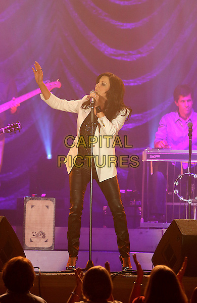 Martina McBride .performs at The Grand Event Center at Green Valley Ranch Station Hotel and Casino, Las Vegas, Nevada, USA, .3rd August 2012..country music on stage live on stage full length white jacket black leather trousers  pants microphone singing hand .CAP/ADM/MJT.© MJT/AdMedia/Capital Pictures.