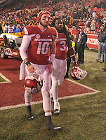 NWA Democrat-Gazette/MICHAEL WOODS • Mississippi University of Arkansas quarterback Brandon Allen (10) and running back Alex Collins (3) head to the locker room following their 51-50 loss to Mississippi State Saturday night at Razorback Stadium November 21, 2015.