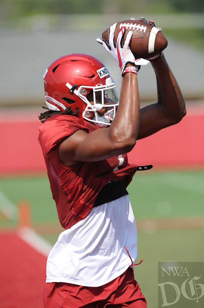 NWA Democrat-Gazette/ANDY SHUPE<br /> Arkansas receiver Trey Knox (7) makes a catch Tuesday, Aug. 6, 2019, during practice at the university practice field. Visit nwadg.com/photos to see more photographs from the practice.