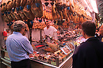 Ham jamon meat stall inside central market building, city of Valencia, Spain