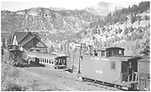 View of RGS section house and railroad car depot at Vance Junction (much disrepair noted).  Two cabooses one being #0400.<br /> RGS  Vance Junction, CO