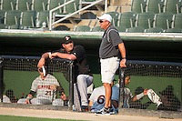Delmarva Shorebirds manager Ryan Minor (44) chats with Kannapolis Intimidators head grounds keeper Billy Ball prior to the game against the Kannapolis Intimidators at Kannapolis Intimidators Stadium on June 23, 2016 in Kannapolis, North Carolina.  The game was suspended in the bottom of the 4th inning due to rain.  (Brian Westerholt/Four Seam Images)