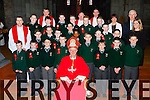 Pupils from the Monastry NS Killarney with Bishop Ray Browne and teachers Mrs Brosnan, Mr O'Suilleabhain, and Noreen O'Leary at their Confirmation in St Mary's Cathedral on Friday