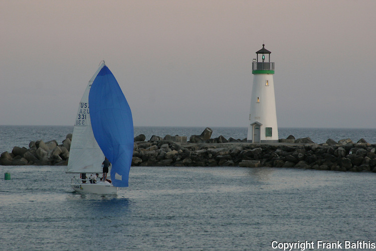 Sailing at dusk near Walton Lighthouse near Santa Cruz