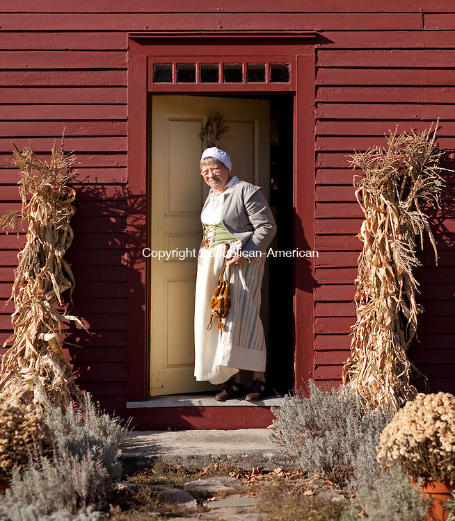 WOODBURY, CT-22 November 2012-112212BF04--FOR COUNTRY LIFE- Volunteer Susan Cheatham from Woodbury is dressed in late 17th century costume at the Hurd House as part of The Old Woodbury Historical Society Thanksgiving Day open house Thursday. Cheatham explained that the early settlers celebrated Harvest Festivals to give thanks and that they were very solemn events. The Hurd House (ca. 1680) is recognized as the oldest original house. It was the home of John Hurd who became the town miller in August 1681.          Bob Falcetti Republican-American