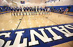 The Marymount Saints listen to the National Anthem before a college volleyball match against PSU Harrisburg at Marymount University in Arlington, Vir., on Wednesday, Oct. 9, 2013.<br /> Photo by Cathleen Allison