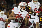 Wisconsin Badgers running back Jonathan Taylor (23) scores a touchdown on a long run during an NCAA College Big Ten Conference football game against the Minnesota Golden Gophers Saturday, November 25, 2017, in Minneapolis, Minnesota. The Badgers won 31-0. (Photo by David Stluka)