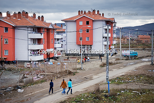 The new apatrment blocks in Roma Mahala in southern Mitrovica. Mahala was destroyed in 1999 when people living there were forced to flee after NATO troops entered Kosovo and Albanians returned. The rebuiding of the Mahala is progressing in phases, with funds from Norway, Ireland, Greece and United Nations Development Programme. Most of the 48 families that this project will resettle are not the Roma who have been living in the IDP camps in the northern Mitrovica.