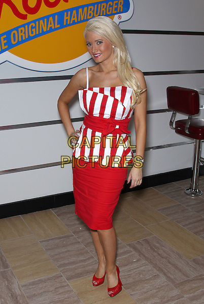 HOLLY MADISON.Appears at the ribbon cutting of the opening of Johnny Rockets at the Flamingo Las Vegas, Las Vegas, Nevada, USA, 10th December 2010..full length hand on hip  belt peep toe  red and white striped top  dress skirt shoes .CAP/ADM/MJT.© MJT/AdMedia/Capital Pictures.