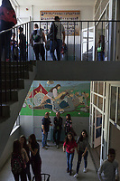 "Serbia. Vranje is a city and the administrative center of the Pčinja District in southern Serbia. « Jovan Jovanović Zmaj » Elementary School. Students and teachers on hallway and stairs. On the bottom floor, the wall painting is about the Battle of Kosovo and the defeat of the Serbian army. The Battle of Kosovo took place on 15 June 1389 between an army led by the Serbian Prince Lazar Hrebeljanović and an invading army of the Ottoman Empire under the command of Sultan Murad Hüdavendigâr. The battle was fought on the Kosovo field  (Kosovo Polje), distant 10 kilometers northwest of Pristina. On the top floor, the portrait pictures of the students. The Pestalozzi Children's Foundation (Stiftung Kinderdorf Pestalozzi) is advocating access to high quality education for underprivileged children. It supports in Vranje a project called "" Education for child rights"".17.4.2018 © 2018 Didier Ruef for the Pestalozzi Children's Foundation"