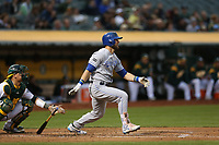 OAKLAND, CA - AUGUST 14:  Alex Gordon #4 of the Kansas City Royals bats against the Oakland Athletics during the game at the Oakland Coliseum on Monday, August 14, 2017 in Oakland, California. (Photo by Brad Mangin)