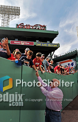 9 June 2012: Washington Nationals General Manager Mike Rizzo signs autographs prior to a game against the Boston Red Sox at Fenway Park in Boston, MA. The Nationals defeated the Red Sox 4-2 in the second game of their 3-game series. Mandatory Credit: Ed Wolfstein Photo