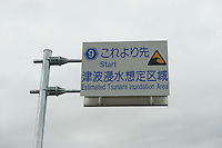 An estimated tsunami inundation area sign during reconstruction efforts following the 311 Tohoku Tsunami in Toni, Japan  © LAN
