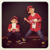 OAKLAND, CA - AUGUST 23: Instagram of young fans of the Los Angeles Angels hanging out on the field before the game against the Oakland Athletics at O.co Coliseum on August 23, 2014 in Oakland, California. Photo by Brad Mangin
