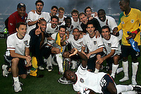 The USA team celebrate with the Nelson Mandela challenge trophy after the match between the national teams of South Africa (RSA) and the United States (USA) in an international friendly dubbed the Nelson Mandela Challenge at Ellis Park Stadium in Johannesburg, South Africa on November 17, 2007. The United States defeated South Africa 1-0.