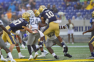 Annapolis, MD - September 8, 2018: Navy Midshipmen quarterback Malcolm Perry (10) jumps into the pile of Memphis Tigers defenders during game between Memphis and Navy at  Navy-Marine Corps Memorial Stadium in Annapolis, MD. (Photo by Phillip Peters/Media Images International)