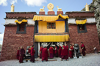 Bon monks arrive to study Buddhist texts at a school in Menri Monastery, which is located 4,700 metres above sea level, in Namling county, Tibet, China, 2015. Menri is a leading Bon monastery in Tibet. The original Bon (Yungdrung Bon) was founded around 16,000 BC,  according to the followers who are called Bonpo. Today, Bon can be found in the more isolated parts of northern and western Tibet. According to the Chinese census, about 10% of Tibetans (about 100,000 people) follow Bon.