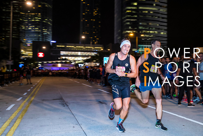 Runners compete at the Bloomberg Square Mile Relay on 9th November 2017 in Hong Kong's Central district, China. Photo by Yu Chun Christopher Wong / Power Sport Images