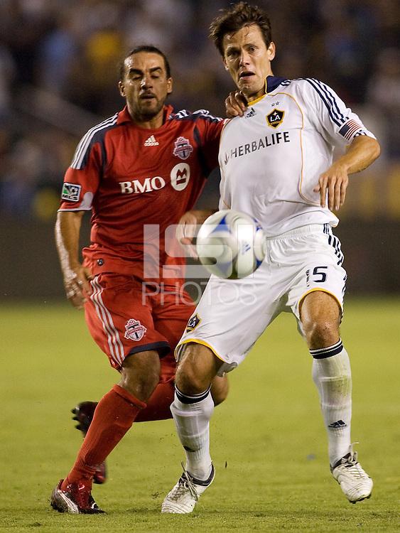 LA Galaxy midfielder Stefani Miglioranzi and Toronto FC's Dwayne De Rosario battle. The LA Galaxy defeated T oronto FC 2-0 at Home Depot Center stadium in Carson, California on Saturday September 19, 2009...