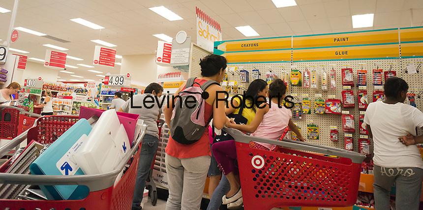 Shoppers at the back-to-school supplies in the Target store in the East Harlem neighborhood of New York on Monday, September 3, 2012. The back-to-school shopping season is the second busiest time for retailers after Christmas.  (© Richard B. Levine)