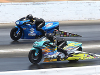 May 16, 2015; Commerce, GA, USA; NHRA pro stock motorcycle rider Jerry Savoie (near lane) races alongside James Underdahl during qualifying for the Southern Nationals at Atlanta Dragway. Mandatory Credit: Mark J. Rebilas-USA TODAY Sports