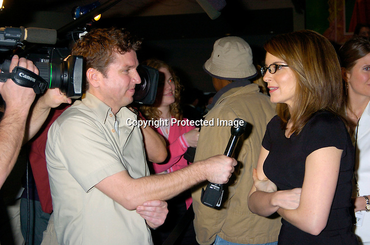 "Tina Fey and the press..at a private screening of ""Mean Girls"" on April 23, 2004 at the Loews Lincoln Square Theatre in New York City. ..Photo by Robin Platzer, Twin Images"