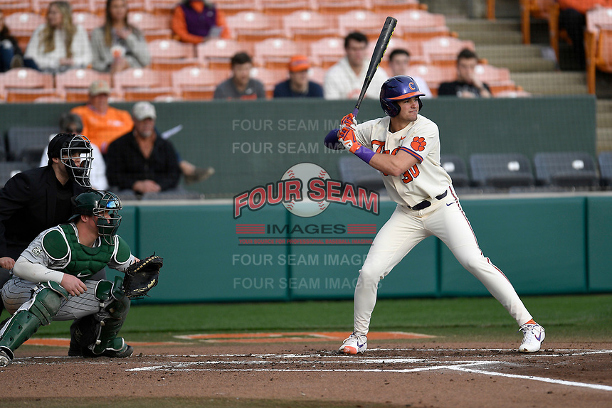 Designated hitter Davis Sharpe (30) of the Clemson Tigers bats in a game against the Charlotte 49ers on Monday, February 18, 2019, at Doug Kingsmore Stadium in Clemson, South Carolina. The catcher is Harris Yett and the umpire is Zach Neff. Clemson won, 7-6. (Tom Priddy/Four Seam Images)