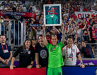 ORLANDO, FL - MARCH 05: Ashlyn Harris #18 of the United States poses with fans after being given a picture during a game between England and USWNT at Exploria Stadium on March 05, 2020 in Orlando, Florida.