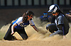 Christine Argentieri #5 of Calhoun, left, tries to tag Alexa Zuniga #9 of Baldwin, who slides safely into third base during a Nassau AA-I/AA-II crossover game at Calhoun High School on Saturday. April 14, 2018. Calhoun won by a score of 9-0.