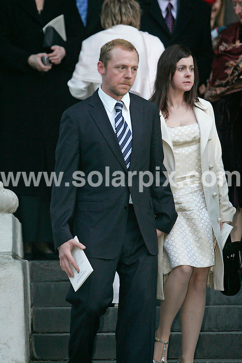 **ALL ROUND PICTURES FROM SOLARPIX.COM**.**NO PUBLICATION IN FRANCE, SCANDANAVIA, AUSTRALIA AND GERMANY** UK RESTRICTIONS: NO NEWSPAPER PUBLICATION, MAGAZINES ONLY**.Lucy Davis, star  of The Office and daughter of comedian Jasper Carrot , married Owain Yeoman at St Paul's Cathedral in Central London on 09.12.06...Picture shows : Simon Pegg..DATE: 09/12/2006-JOB REF: 3152/SFE.**MUST CREDIT SOLARPIX.COM OR DOUBLE FEE WILL BE CHARGED**