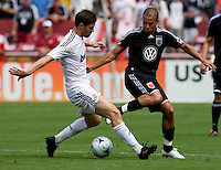 Real Madrid midfielder (22) Xabi Alonso fights for the ball with DC United midfielder (7) Fred during their friendly at FedEx Field in Landover, Maryland.  Real Madrid defeated DC United, 3-0.