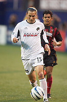 Chad Deering of the Burn being trailed by Amado Guevara of the MetroStars. The Dallas Burn were defeated by the NY/NJ MetroStars 2-1 on 5/24/03 at Giant's Stadium, East Rutherford, NJ.