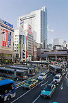 Buses and other vehicles pass through a busy junction in central Tokyo, Japan on 03 Feb. 2012. Photographer: Robert Gilhooly