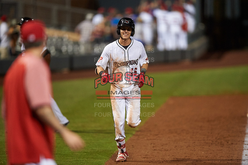 Scottsdale Scorpions Nick Maton (16), of the Philadelphia Phillies organization, jogs toward home plate after hitting a walk-off home run during an Arizona Fall League game against the Glendale Desert Dogs on September 20, 2019 at Salt River Fields at Talking Stick in Scottsdale, Arizona. Scottsdale defeated Glendale 3-2. (Zachary Lucy/Four Seam Images)