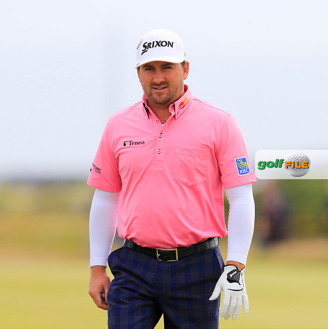 Graeme McDOWELL (NIR) sinks his putt on the 15th green during Monday's Final Round of the 144th Open Championship, St Andrews Old Course, St Andrews, Fife, Scotland. 20/07/2015.<br /> Picture Eoin Clarke, www.golffile.ie