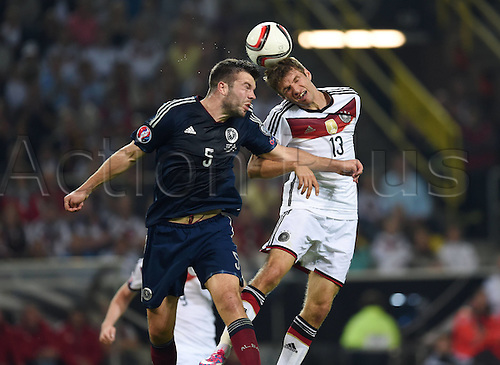 07.09.2014. Dortmund, Germany.   international match Germany Scotland  in Signal Iduna Park in Dortmund. Thomas Mueller Germany right against Grant Hanley Scotland