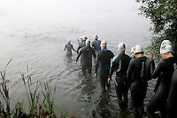 17 JUL 2005 - ASHFORD, GBR - Competitors wade into the water for the start of the Ashford Triathlon (PHOTO (C) NIGEL FARROW)