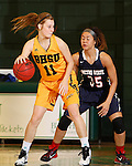 JANUARY 31, 2015 -- Taylor Trohkimoinen #11 of Black Hills State shields the ball from Metro State defender Luisa Tago #35 during their Rocky Mountain Athletic Conference women's basketball game Saturday evening at the Donald E. Young Center in Spearfish, S.D.  (Photo by Dick Carlson/Inertia)
