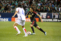 Mexico's Andres Guardado dirbbles away from Costa Rica's Jose Salvatierra.  Mexico defeated Costa Rica 4-1 at the 2011 CONCACAF Gold Cup at Soldier Field in Chicago, IL on June 12, 2011.